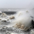Waves crash over the promenade in Blackpool - Ireland has similarly been pounded by gale force winds this week and one woman died in Dublin when she was hit by a falling tree.<span class=