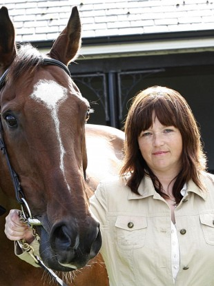 Sharon Newsome and rescued horse Moscow