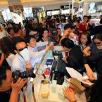 A crowd gathers at the first duty-free shop on Sanya in south China as part of the island province's efforts to make it a tourist and shopping attraction. Image: Luo yunfei/PA