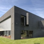 ...a huge metal shutter descends and heavy concrete panels swing over the windows...<span class=