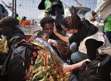 A mother and he child receiving treatment on Lampedusa