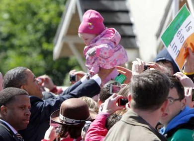 Oh baby! This little girl doesn't know it yet, but this is the day she was cuddled by US President Barack Obama on his trip to Moneygall