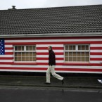 A house painted with a US flag in Moneygall, Co Offaly, where Barack Obama has ancestral links (AP Photo/Matt Dunham)