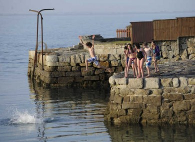 Swimmers enjoy the sun at Sandycove