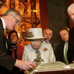 The Queen is shown a facsimile copy of the Book of Kells by Trinity College librarian Robin Adams, before being led to the chamber housing the original copy. (Photo: Maxwells)