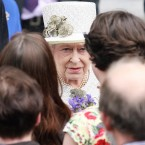 Finally, getting the opportunity to meet with the public for the first time, the Queen smiles as she shakes hands with a selection of students and staff from Trinity College before retiring for the day. (Photo: Maxwells)