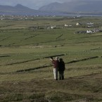 Tourists use their iPad to video the landscape in Dingle, Co Kerry (Eamonn Farrell/Photocall Ireland)