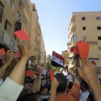 Protestors show Assad and his family the