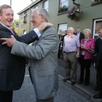 Enda Kenny is greeted by Dr Joe Mulholland at the 31st Annual MacGill Summer School in Glenties, Co Donegal. (Photo Eamonn Farrell/Photocall Ireland)