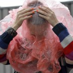 Reanne Vantoor from the Netherlands takes cover from the rain. (Mark Stedman/Photocall Ireland)