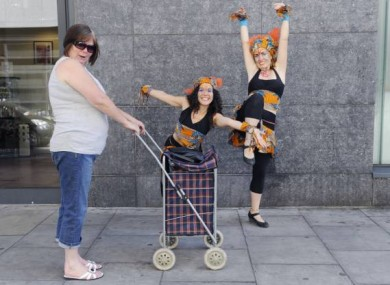 June Carthy from Cabra takes a look at Soraya Sobreiva (left) and Stephanie Lysaght from Wassa Wassa Drum Collective as they launched the Northside Music Festival 2011
