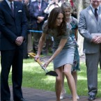 Kate puts her back into the tree-planting ceremony.