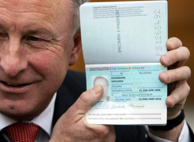 Former justice minister Dermot Ahern poses with a new 'e-passport'. Irish students travelling in the US have been found doctoring their passports, trying to pass themselves off as being over 21.
