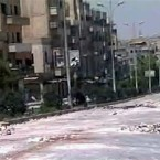 In this photo taken yesterday and released by the Syrian official news agency SANA, empty streets with debris are shown of what SANA describes as the Syrian army restoring