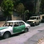 Damaged cars are shown in Hama. (AP Photo/SANA)