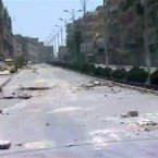 In this photo released by the Syrian official news agency SANA, empty streets with debris are shown of what SANA describes as the Syrian army restoring