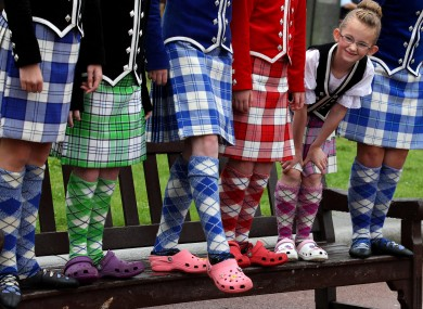 Seven year-old Amy Laughlin from the Mary Ann-Mcreadie Dance school in Paisley with dancers as they show off their traditional costume in Glasgow, before they join six bands competing in this weekend's World Pipe Band Championship.