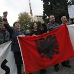 Pictured are Albanian immigrants in Greece during a protest in central Athens. When the Greek economy slides foreign workers may lose jobs and stop sending money home. Macedonia, Montenegro, Bulgaria and Romania are also strong trading partners with Greece. Image: AP Photo/Kostas Tsironis