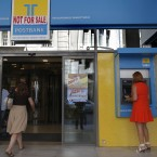 Greek banks hold €45.3 billion in Greek debt. Image: AP Photo/Petros Giannakouris