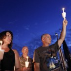 People hold candles during a vigil at the Garden of Reflection in Pennsylvania. 