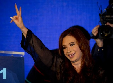 Argentina's President Cristina Fernandez flashes a victory sign while celebrating with supporters
