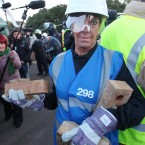 An Enforcement Officer carries away bricks from Dale Farm. (Gareth Fuller/PA Wire)