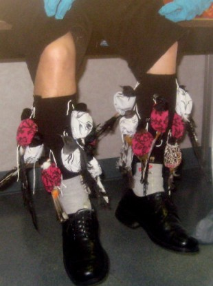 detained suspect Sony Dong, with songbirds strapped to his legs at Los Angeles International Airport