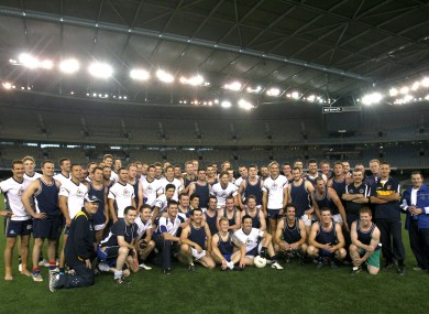 Australia and the Victoria State GAA team pose for a picture after their practice game in the Etihad Stadium.
