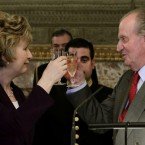 Mary McAleesen and Spain's King Juan Carlos raise a toast during a lunch at the Royal Palace in Madrid on 21 March 2011.   (AP Photo/Sergio Barrenechea, Pool)