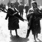 Children in Dublin with wood scavenged from the ruins of Sackville (now O'Connell) Street in the 1916 Rising. Image: Mercier Archives
