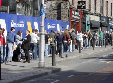 People waiting for the dole office at Bishop Square in Dublin to open. The unemployment rate is currently 14.2 per cent