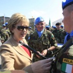 McAleese pins a medal to an Irish UN peacekeeper soldier at their base in the southern village of Tebnine, Lebanon on 15 Ocober.   McAleese spent three days visiting Lebanese officials and checking in with the Irish soldiers serving with the UN peacekeeping unit.  (AP Photo/Mohammed Zaatari)
