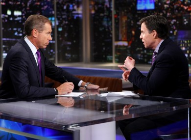 NBC News anchor Brian Williams, left, talks with Bob Costas about Costas' interview with Jerry Sandusky.