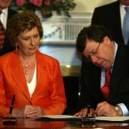 7 May 2008: President Mary McAleese and new Taoiseach Brian Cowen sign the seal of office in Aras an Uachtarain.  (Julien Behal/PA Archive/Press Association Images)
