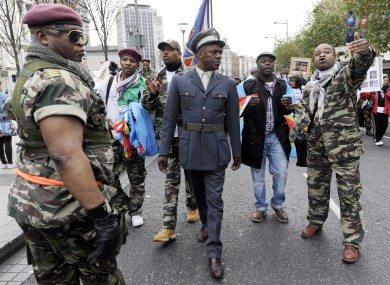 Members of the Democratic Republic of Congo (DRC) community in Dublin hold a protest against incumbent President Joseph Kabila on O'Connell Street today. DRC goes to the polls on Monday.