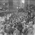 Crowds at Nelson's Pillar on O'Connell Street are all eager to catch a glimpse of the new President.