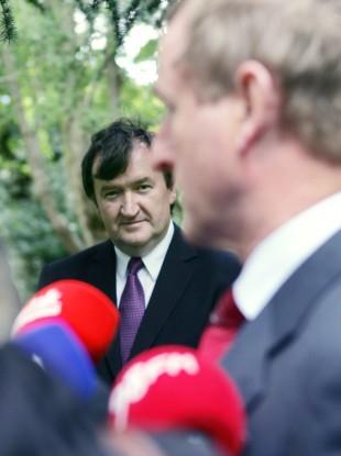 David Gunning looks on as Taoiseach Enda Kenny speaks to the media in September.