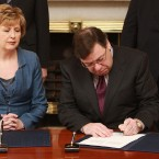 Taoiseach Brian Cowen signing his request to President Mary McAleese to dissolve the Dail on 1 February. Pic: Sasko Lazarov/Photocall Ireland.