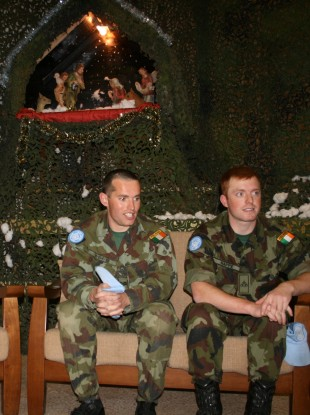 Soldiers discuss their Christmas plans at Camp Shamrock in Tibnin, Lebanon