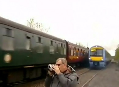 A trainspotter narrowly avoids being struck by a train in the UK