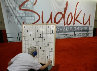 A contestant works on his puzzle in the final round during the Philadelphia Inquirer Sudoku National Championship.