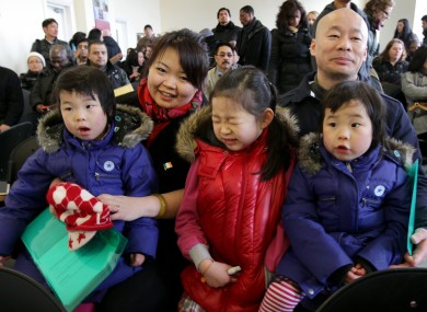 He Huang and Jun Ti Tao with daughters Ashling, Angie and Alison