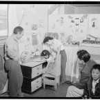 Tōyō Miyatake standing by his daughter's desk in her bedroom as her mother speaks to the young girl. (Library of Congress, Prints & Photographs Division)