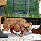 Detail of a mosaic of a dog being walked on the station platform (Via mural-to-mosaic.blogspot.com)