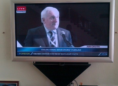 Ahern, pictured on TV, speaking at the investors' forum yesterday.