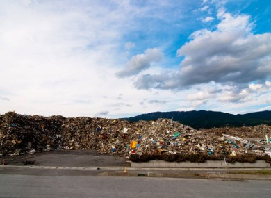 Piles of debris in Japan as it attempts to rebuild in the aftermath of the unprecedented disaster a year ago.