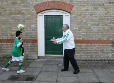 John Giles with a young footballer this week after he was announced as the Grand Marshal for this year's Patrick's Day parade
