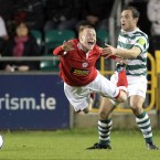 Shelbourne's Lorcan Fitzgerald (over)eacts to a challenge from Shamrock Rovers' Stephen Rice.<span class=