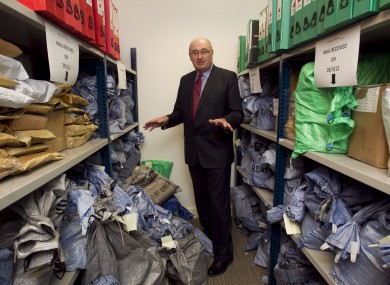 Phil Hogan looking at mailbags filled with household charge registration forms