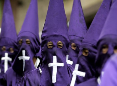 Members of the Nazarenos brotherhood walk during a Holy Week procession in Zipaquira, Colombia,